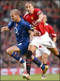 Rio Ferdinand (right) tangles with Freddie Ljungberg in one of the game's key moments