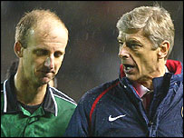 Arsene Wenger (right) has been asked to explain his comments about referee Mike Riley