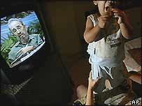 Fidel Castro announces the new measures on TV in a Cuban home