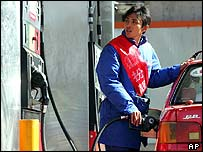 An attendant pumps petrol in Beijing