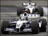 Williams' Juan Pablo Montoya leads McLaren's Kimi Raikkonen on the way to victory in the Brazilian Grand Prix