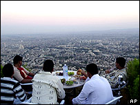 Damascus cafe-goers watch the sunset