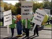 Asda workers dressed as pieces of fruit protest outside court