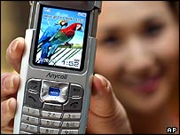 Girl holding a picture mobile phone