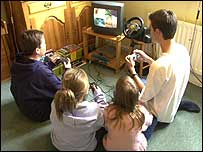 Group of teenagers playing PlayStation