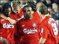 Liverpool celebrate Salif Diao's (l) goal