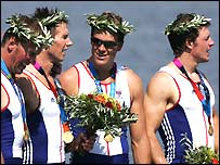 Matthew Pinsent, Ed Coode, James Cracknell and Steve Williams celebrate Olympic gold on the podium