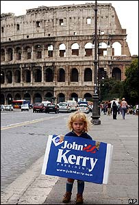 Child holding up Kerry poster in Rome