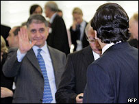 Italian justice commissioner-designate Rocco Buttiglione (left) waves to Jose Manuel Barroso