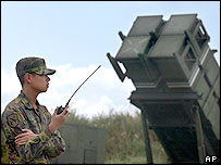 A Taiwanese soldier stands in front of one of Taiwan's many Patriot missile air defence systems Friday, Oct. 22, 2004, near the northern coastal town of Wanli, Taiwan.