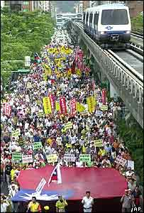 Several thousand protesters take the streets of the capital to denounce an arms deal with the U.S., Saturday, Sept. 25, 2004, in Taipei, Taiwan.