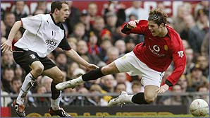 Fulham's Adam Green takes on Man Utd's Ronaldo