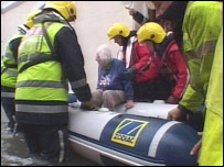 An elderly resident is evacuated at Looe