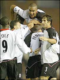 Mark Pembridge is congratulated by his his Fulham team-mates after the winner at Birmingham