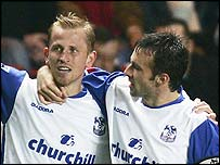 Dougie Freedman congratulates Sandor Torghelle after he scored the winner for Crystal Palace