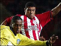 Southampton's Leon Best challenges Colchester's Neil Danns