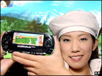 A model shows off Sony's new PlayStation Portable