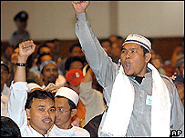 Supporters of militant cleric Abu Bakar Bashir shout 'Allahuakbar!' (God is great) during his trial in Jakarta, 28 Oct