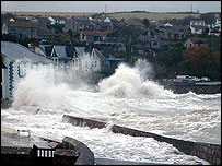 A giant wave hits the South Cornwall Seaside town of Portmellon