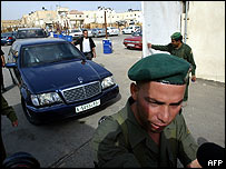 Palestinian police supervise traffic into the compound on Thursday