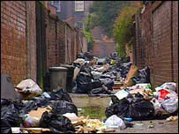 Rubbish piled up in back lane   BBC