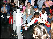 Children playing pass-the-parcel at the Science Museum in London