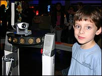 Child and prototype robot at the Science Museum in London