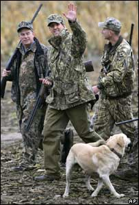 John Kerry (centre) returns from a goose hunting trip in Ohio