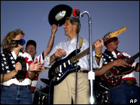 John Kerry plays the guitar while attending a rally in Jefferson City, Missouri (August 2004)
