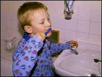Image of a boy brushing his teeth