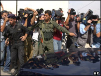 Police restrain journalists in the West Bank
