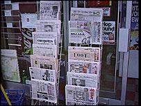Newspaper rack outside newsagent