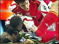Van Persie is mobbed by his Arsenal team-mates
