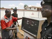 Policemen buying fuel in Nigerian capital Lagos
