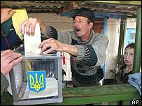 A voter casts his ballot in Gvozdov, south of Kiev