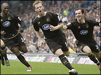 Alan Mahon celebrates his opener for Wigan at Leeds