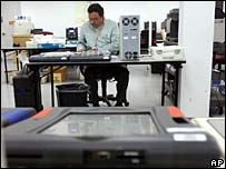 Election worker in Florida inspects voting machine