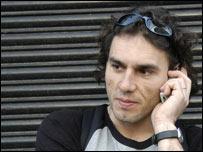 Man listening to mobile phone, BBC