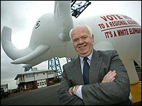 John Elliott in front of the No Campaign's inflatable white elephant