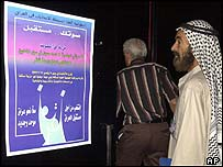 Voter contemplates poster explaining Iraqi election