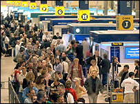 Passengers check in at Heathrow