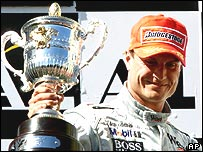 David Coulthard celebrates winning the 2001 Austrian Grand Prix