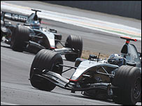 David Coulthard leads McLaren team-mate Kimi Raikkonen at the 2004 French Grand Prix