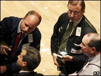 Traders watching a screen on the New York stock exchange