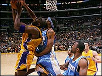 Kobe Bryant (left) of the LA Lakers playing against Denver
