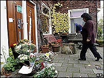 Mourner leaves flowers at home of Theo van Gogh