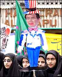 Protesters in Tehran parade an effigy of George Bush