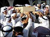 Mourners with Sheikh Zayed's coffin