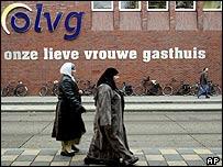 Muslim women pass Amsterdam hospital where suspect was treated