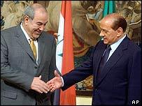 Iraqi interim Prime Minister Iyad Allawi (left) meets Italian Prime Minister Silvio Berlusconi